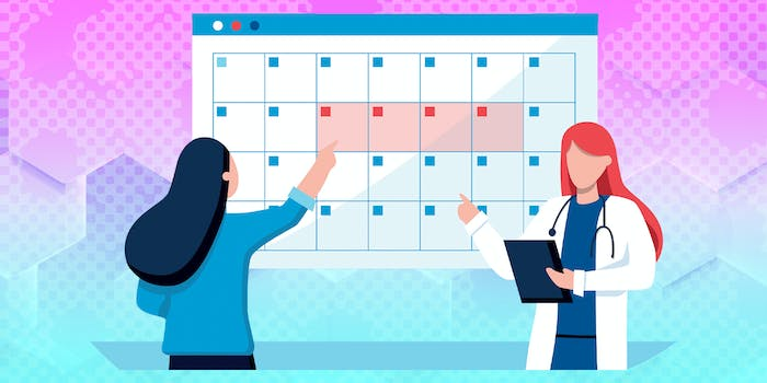 woman pointing to calendar with doctor