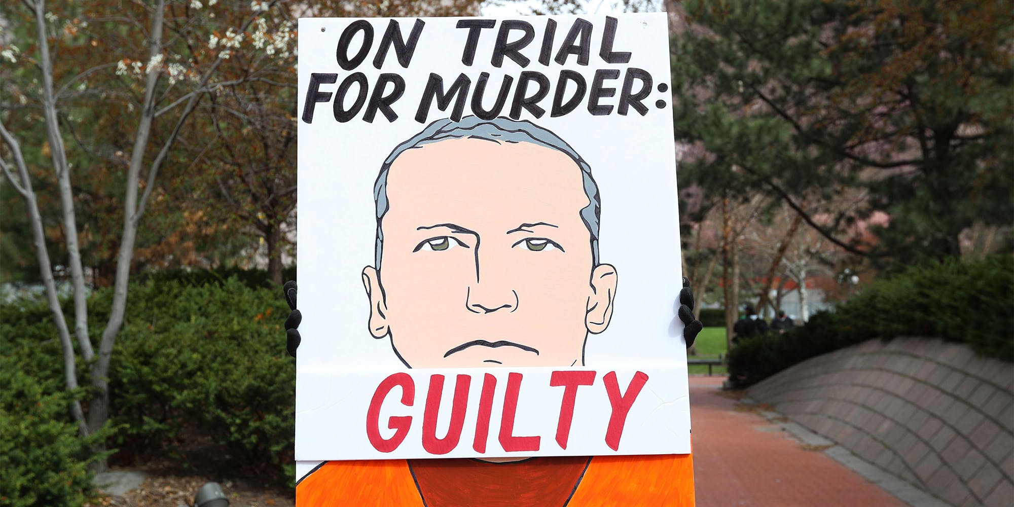 """""""On trial for murder: Guilty"""" sign with illustration of Derek Chauvin"""