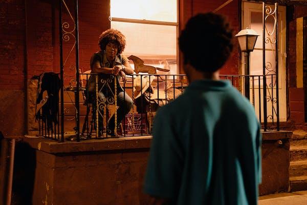 woman talks to teenage boy outside her home