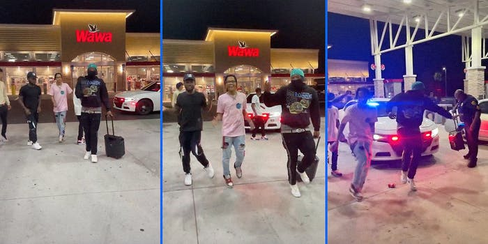 A group of kids dancing in front of a gas station with a cop car in the background.
