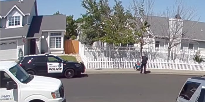 screengrab showing officer over sitting child