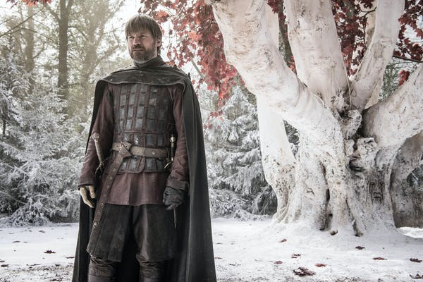 jaime lannister stands in front of white tree