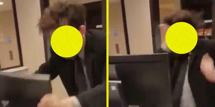 A hotel clerk hitting his computer and himself.