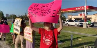 People protesting the handling of a wastewater disaster in Florida
