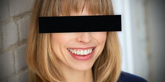 A woman with eyes blacked out.