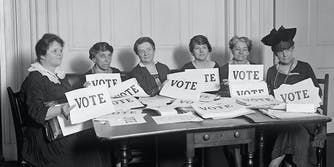 A group of women with 'Vote' signs.