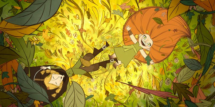 two girls laying in leaves