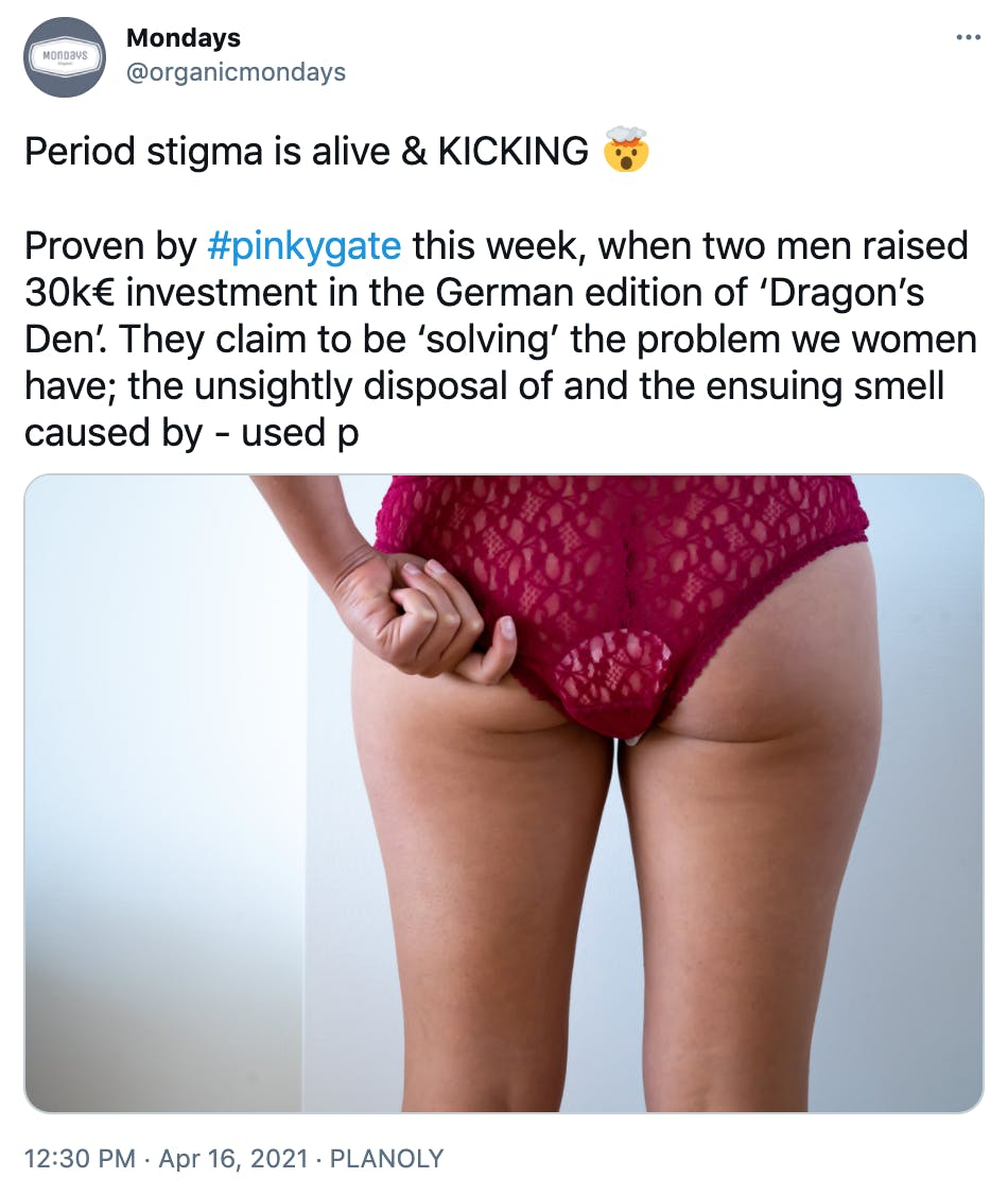 """""""Period stigma is alive & KICKING 🤯  Proven by #pinkygate this week, when two men raised 30k€ investment in the German edition of 'Dragon's Den'. They claim to be 'solving' the problem we women have; the unsightly disposal of and the ensuing smell caused by - used p"""" photograph of the buttocks and legs of a dark skinned woman wearing red lace underwear and a period pad"""