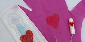A sanitary napkin, pink glove, and tampon.