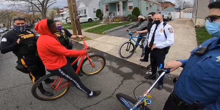 police surround teenagers on bicycles