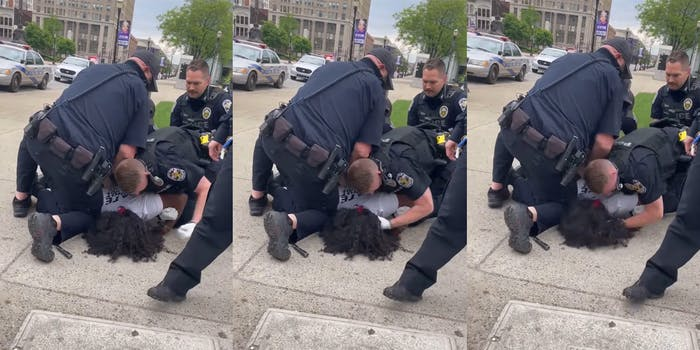 police officer punches man in the head while three other officers hold him down