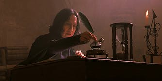 Professor Snape using an inkwell