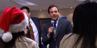 Michael Scott (played by Steve Carell) singing into a microphone.