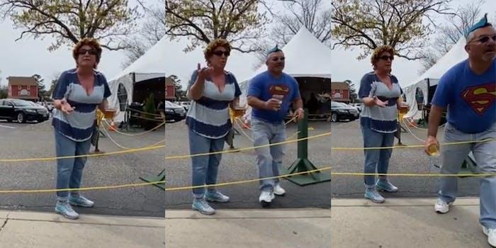 man walks up behind woman and throws beer at someone off-camera