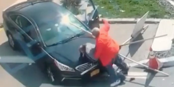 video shows man beating up man suspected of killing his girlfriend
