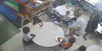 screenshot of live stream featuring only the white kids in a daycare center class eating