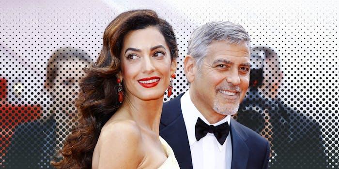 George and Amal Alamuddin Clooney smiling.