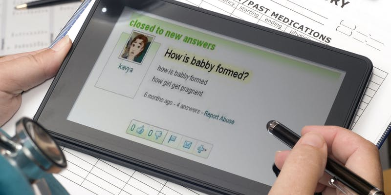 """doctor holding tablet with """"How is babby formed?"""" Yahoo! Answers question"""