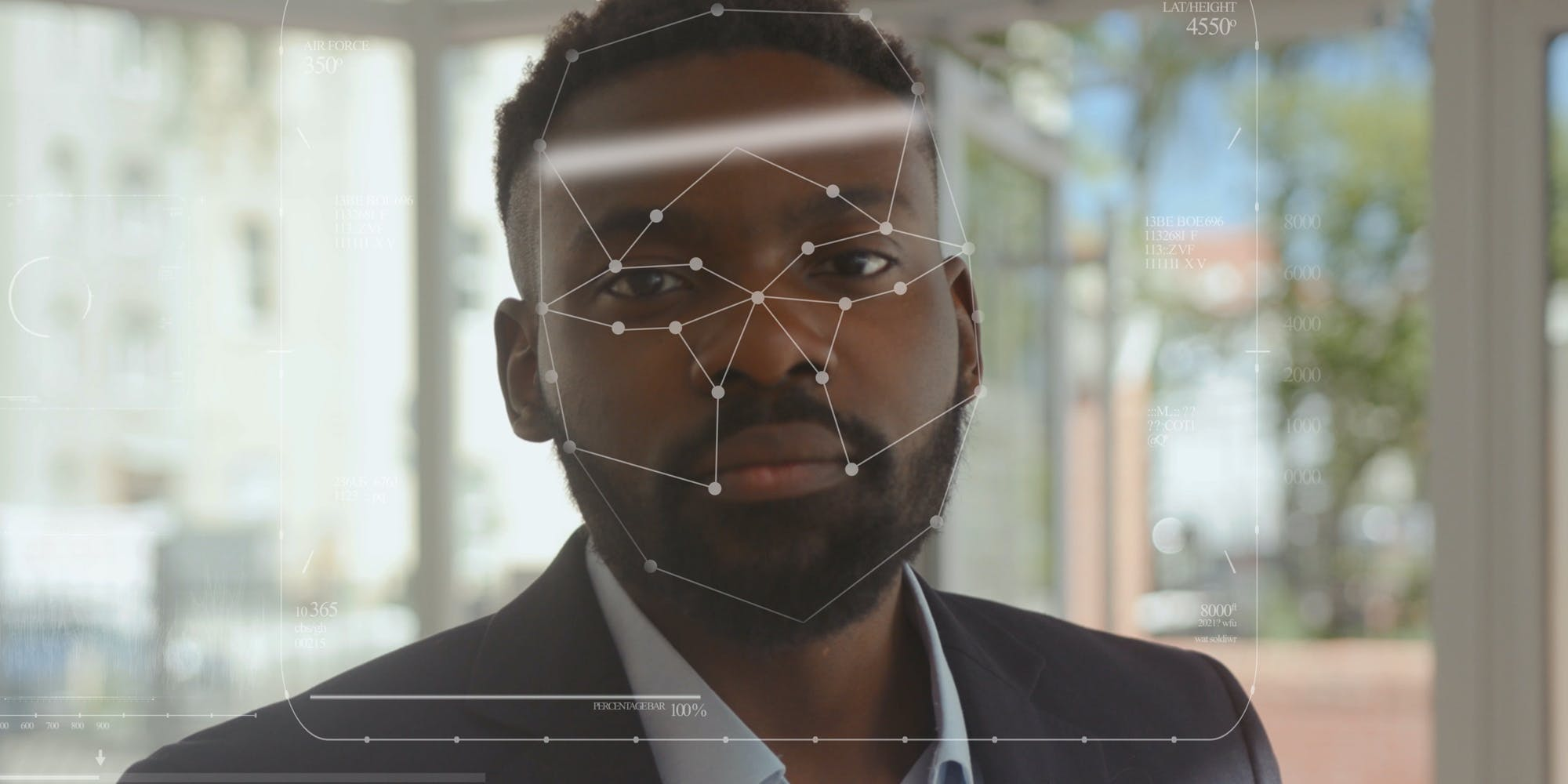 A man being scanned with facial recognition technology.