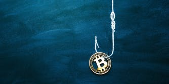 A Bitcoin on the end of a fishing line and hook. It is meant to represent a cryptocurrency scam.