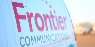A logo on the side on a Frontier Communications van.