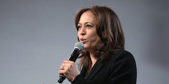 Vice President Kamala Harris speaking into a microphone.