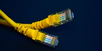 Two ethernet cables delivering broadband internet.