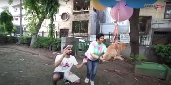Delhi-based YouTuber Gaurav Sharma and his mom flying their dog by tying several balloons to the dog's waist