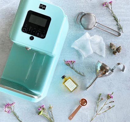 LEVO II device lays next to herbs and measuring spoons
