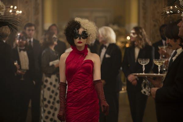 cruella in red dress