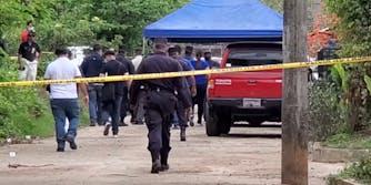 police walk behind police tape