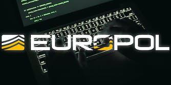 A hacker typing on a keyboard.