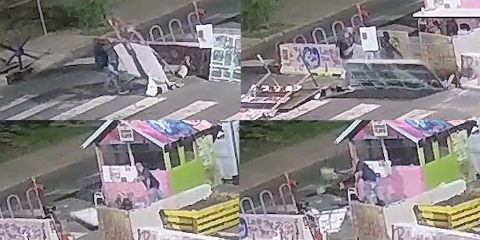 man tearing down memorial site at George Floyd Square in Minneapolis