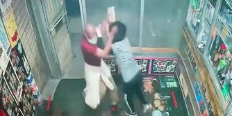 A man attacking a woman with a cement block.