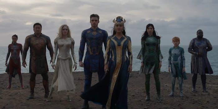 people in superhero costumes on beach