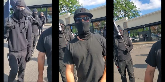 young men dressed in black with masks, hoods, hats and glasses