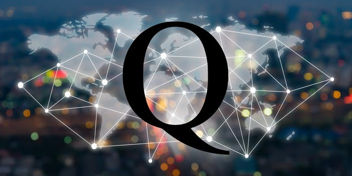 The letter Q over a world map.