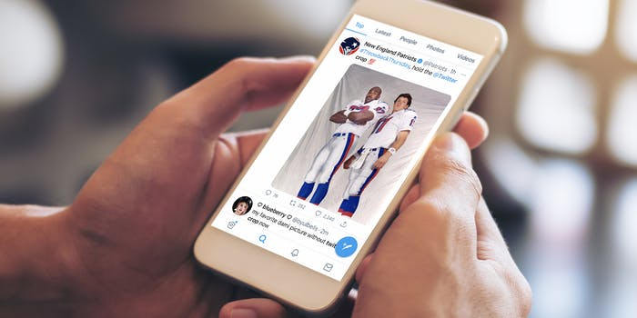 person holding phone with new england patriots tweet of players