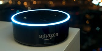 An Amazon Echo dot version 2 on a white table.
