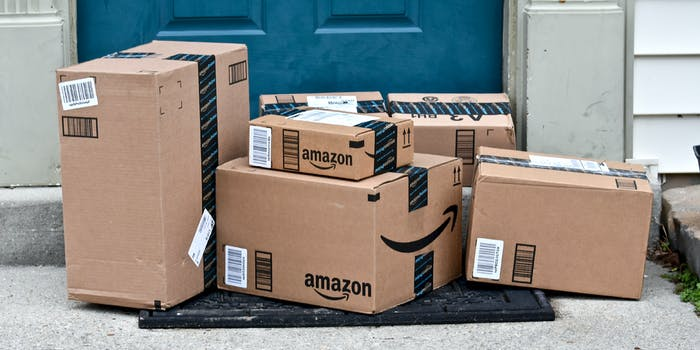 A group of Amazon boxes outside of someone's front door.