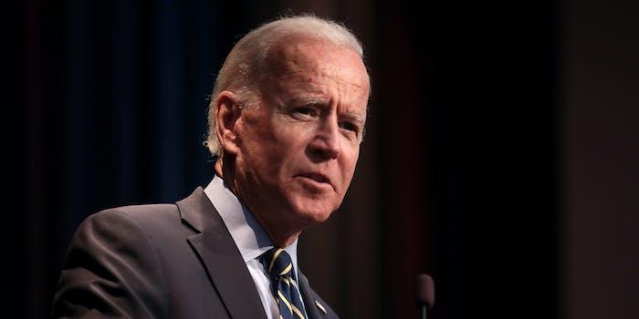 President Joe Biden speaking into a microphone.