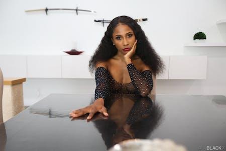 Olivia Jayy stares seductively at the camera for All Black X photoshoot