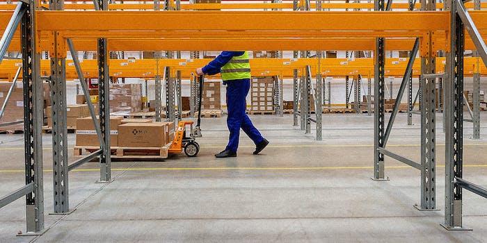 A man walking in a warehouse.