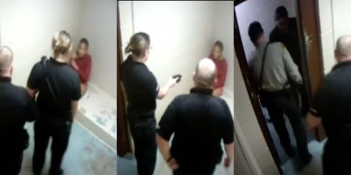 Cops point a taser at Ariel Harrison in McDonough County Jail in Macomb, IL.