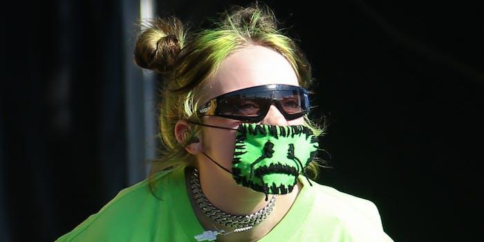 Billie Eilish wearing green facemask