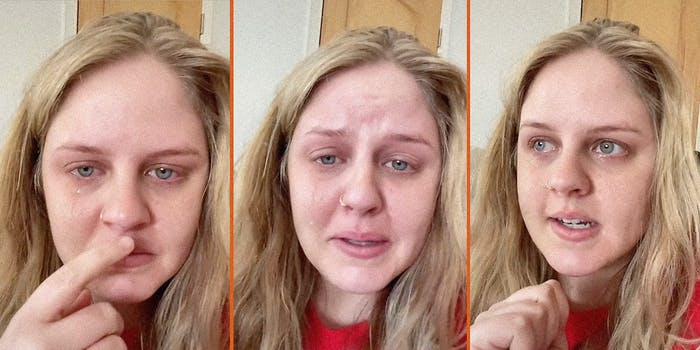 A woman crying while talking into the camera.