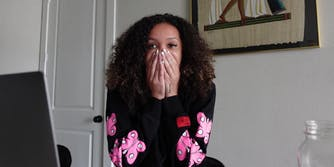 A female Youtuber covering her mouth