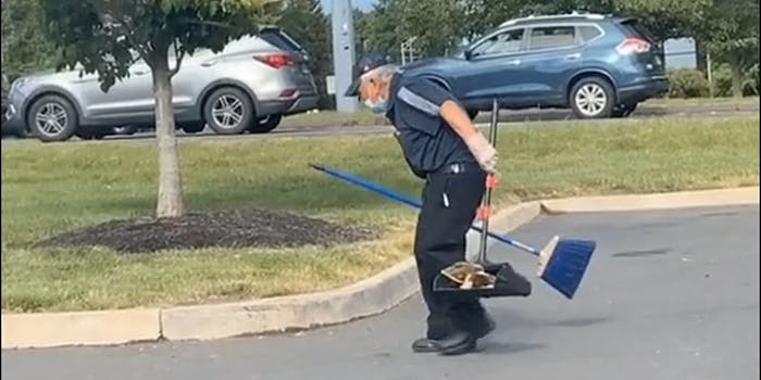 man cleaning up mcdonalds parking lot
