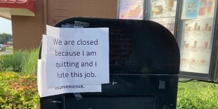 """McDonald's drive-thru with """"We are closed because I am quitting and I hate this job."""" sign taped to speaker"""
