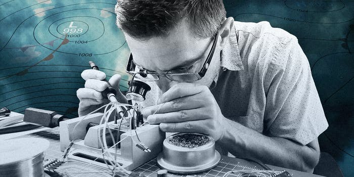 A man working on a thermostat.